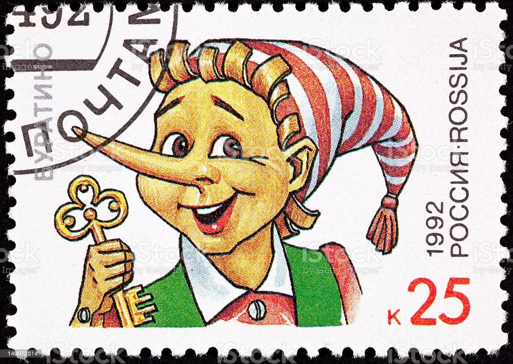 Canceled Russian Postage Stamp Pinocchio Puppet Holding Gold Key royalty-free stock photo