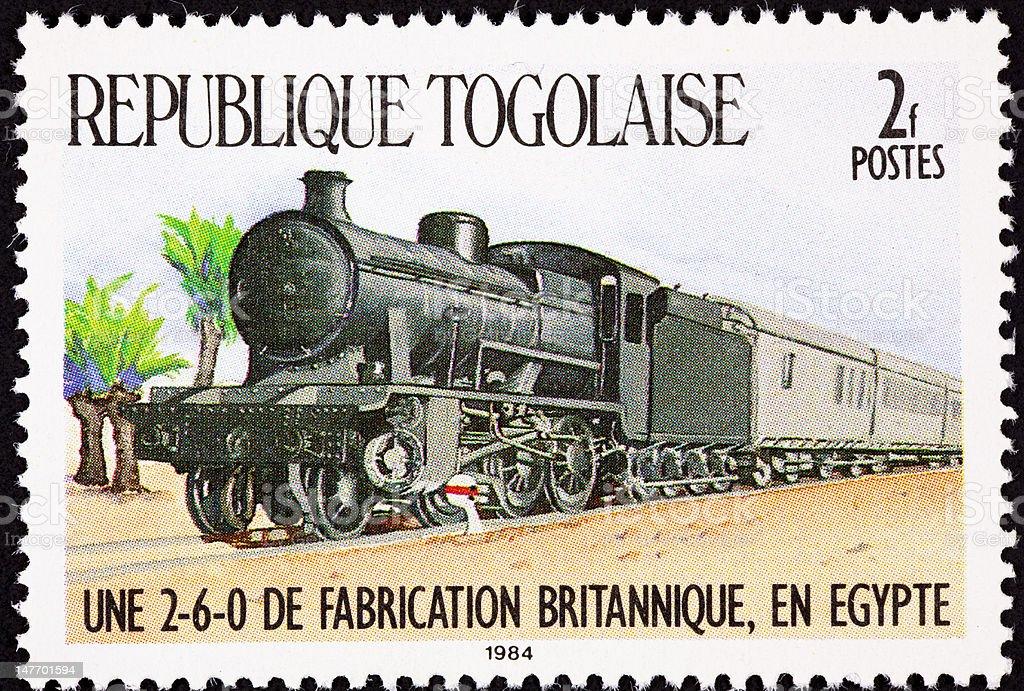 Canceled Togo Postage Stamp Railroad Steam Locomotive Train Cars Egypt royalty-free stock photo