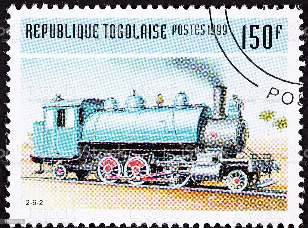 Canceled Togo Train Postage Stamp Old Railroad Steam Engine Locomotive royalty-free stock photo