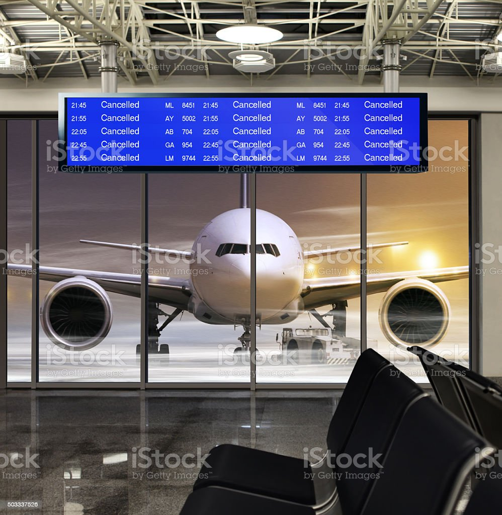 cancelled flight in airport stock photo