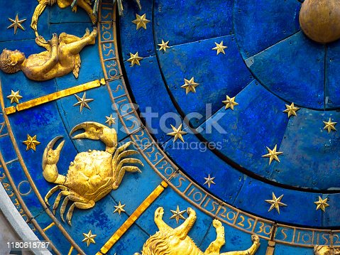 istock Cancer astrological sign on ancient clock. Detail of Zodiac wheel with crab. 1180618787