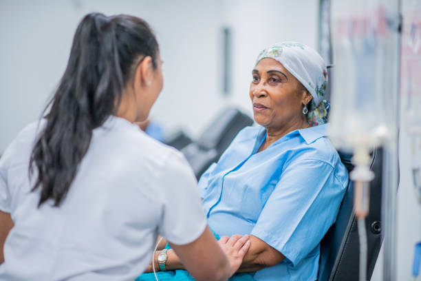 Cancer Patient Receiving Treatment stock photo Cancer patient receiving support from her doctor outpatient stock pictures, royalty-free photos & images