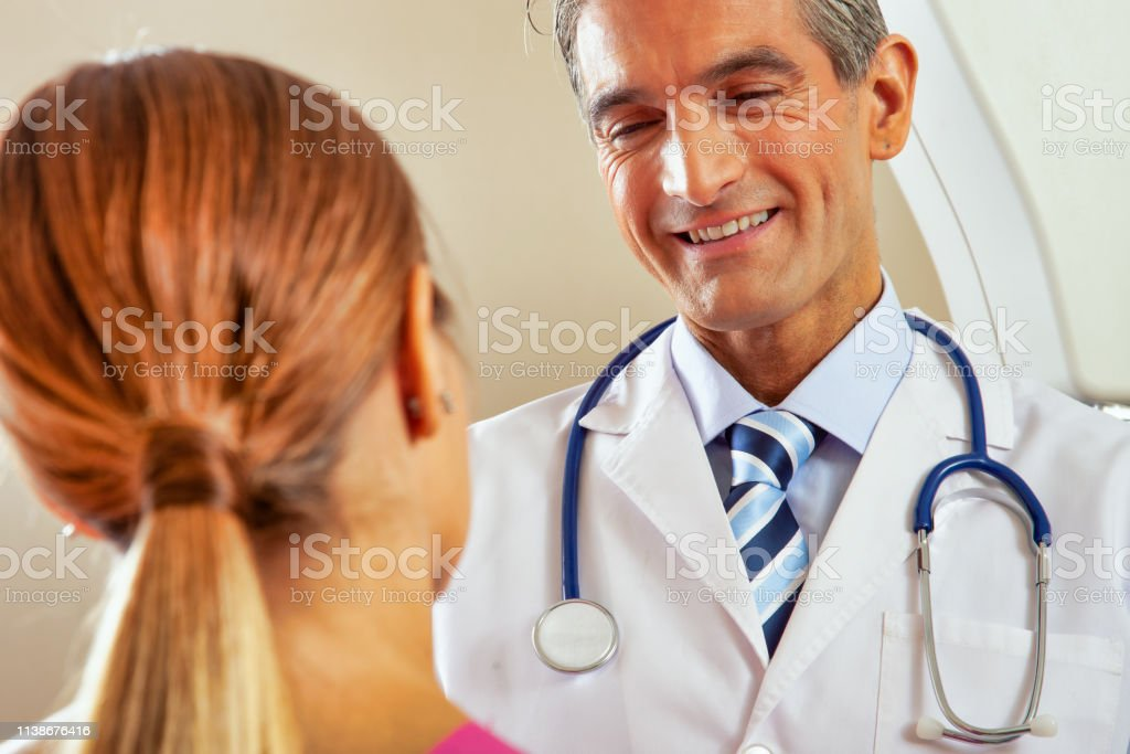 Cancer prevention concept. Doctor and patient before the mammogram.