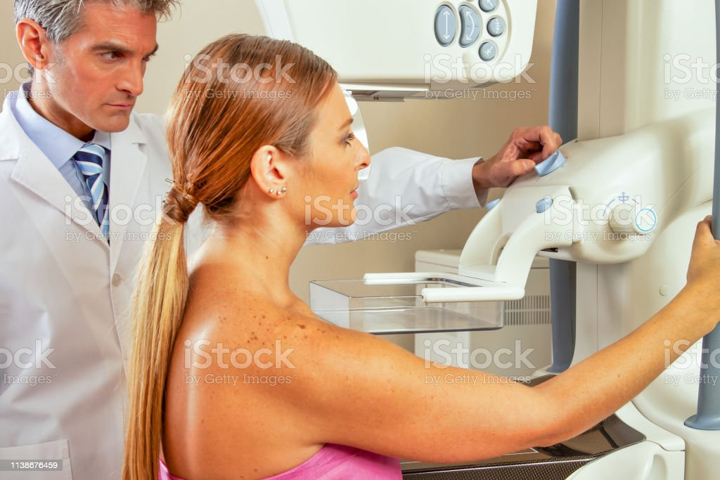 Cancer prevention concept. Doctor prepares patient for mammography...