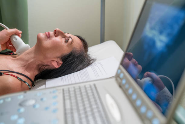 Cancer prevention. Health and medicine. Patient woman from the endocrinologist for thyroid gland ultrasound Cancer prevention. Health and medicine. Patient woman from the endocrinologist for thyroid gland ultrasound. endocrine system stock pictures, royalty-free photos & images