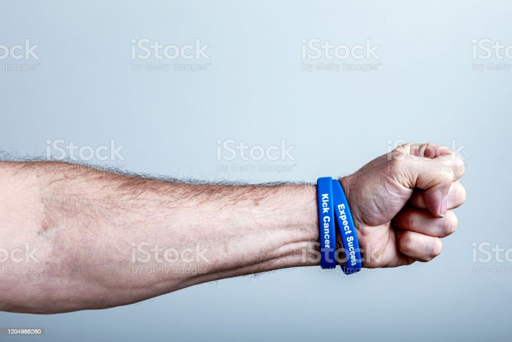 Cancer Survivor Fist And Support Wristbands Stock Photo Download Image Now Istock