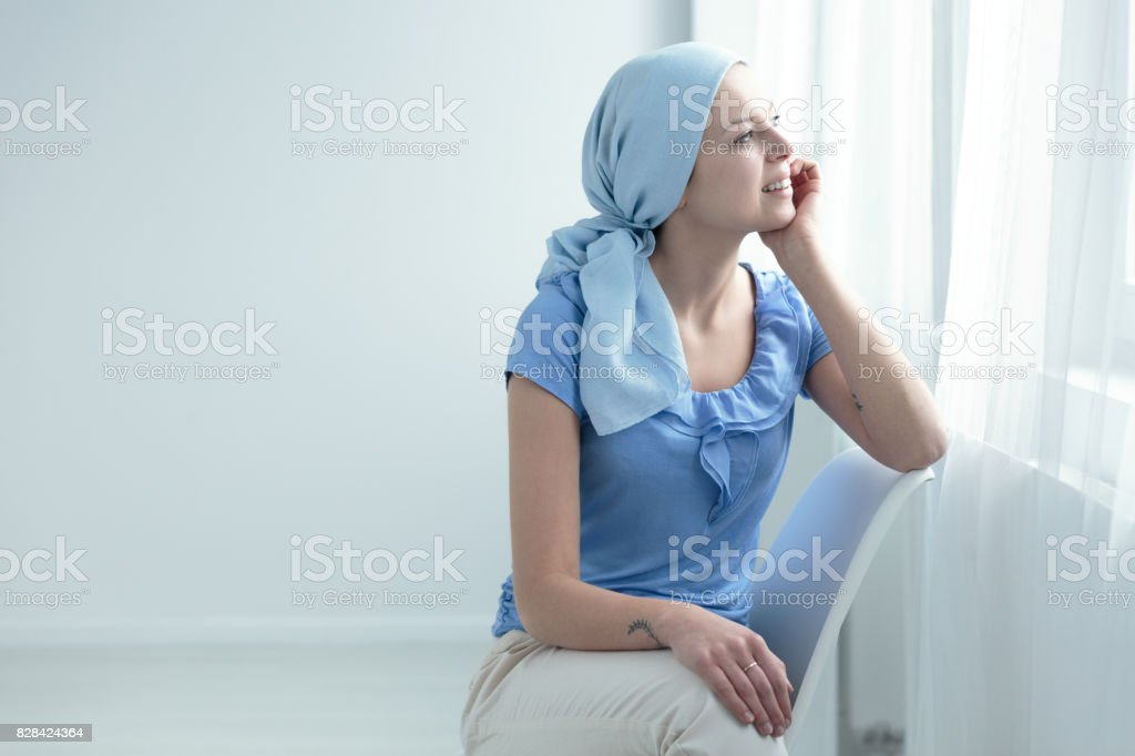 Cancer survivor sitting on chair stock photo