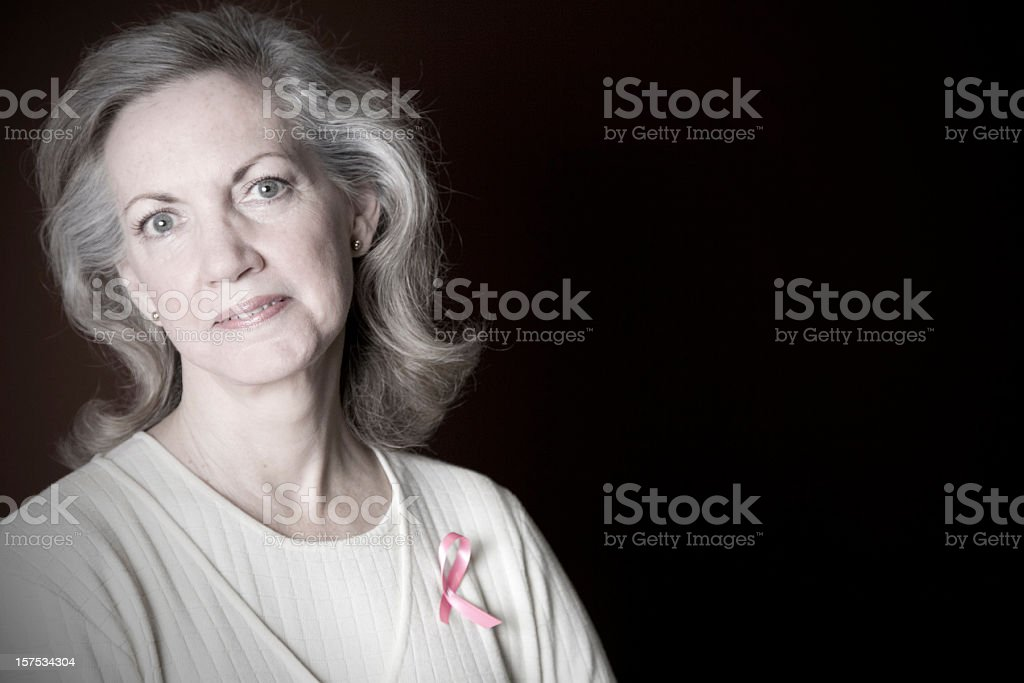 Cancer Survivor with Pink Ribbon on royalty-free stock photo