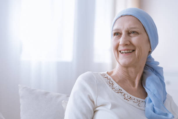 cancer woman smiling with hope - battle of the sexes concept stock pictures, royalty-free photos & images