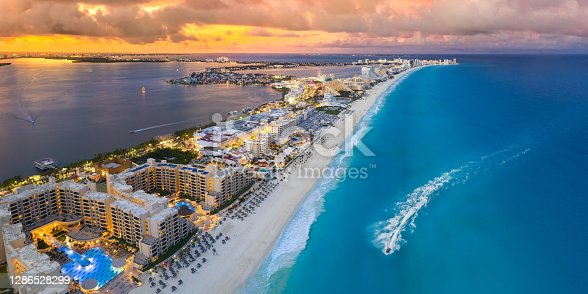 Cancun beach coast during blue hour with sunset