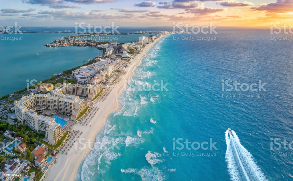 Cancun beach with boat stock photo