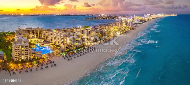 sunset on a Cancun resort with blue water