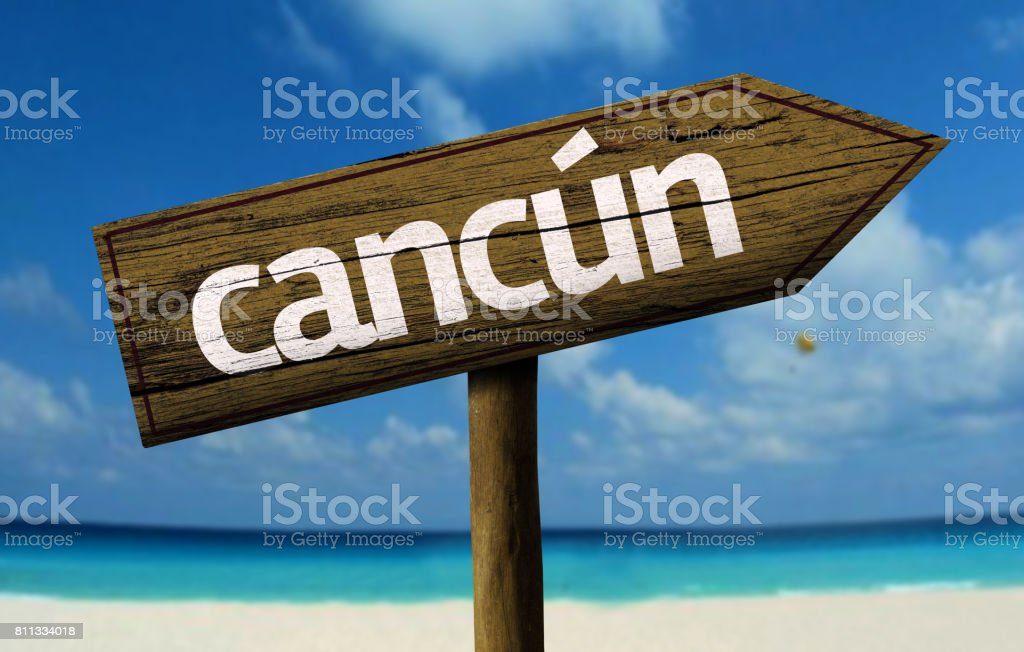 Cancun wooden sign on the beach stock photo