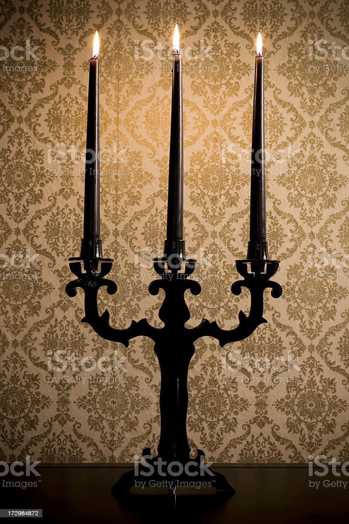 Candelabra with Lit Black Halloween Candles, Copy Space stock photo