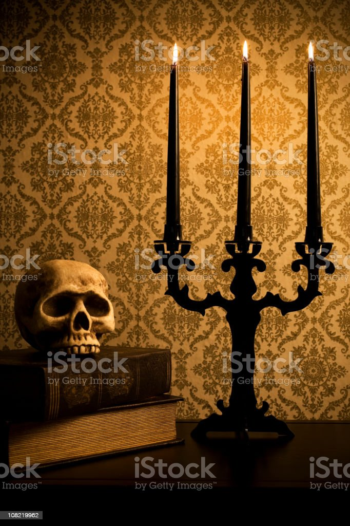 Candelabra with Skull and Old Books, Spooky Halloween Photo royalty-free stock photo