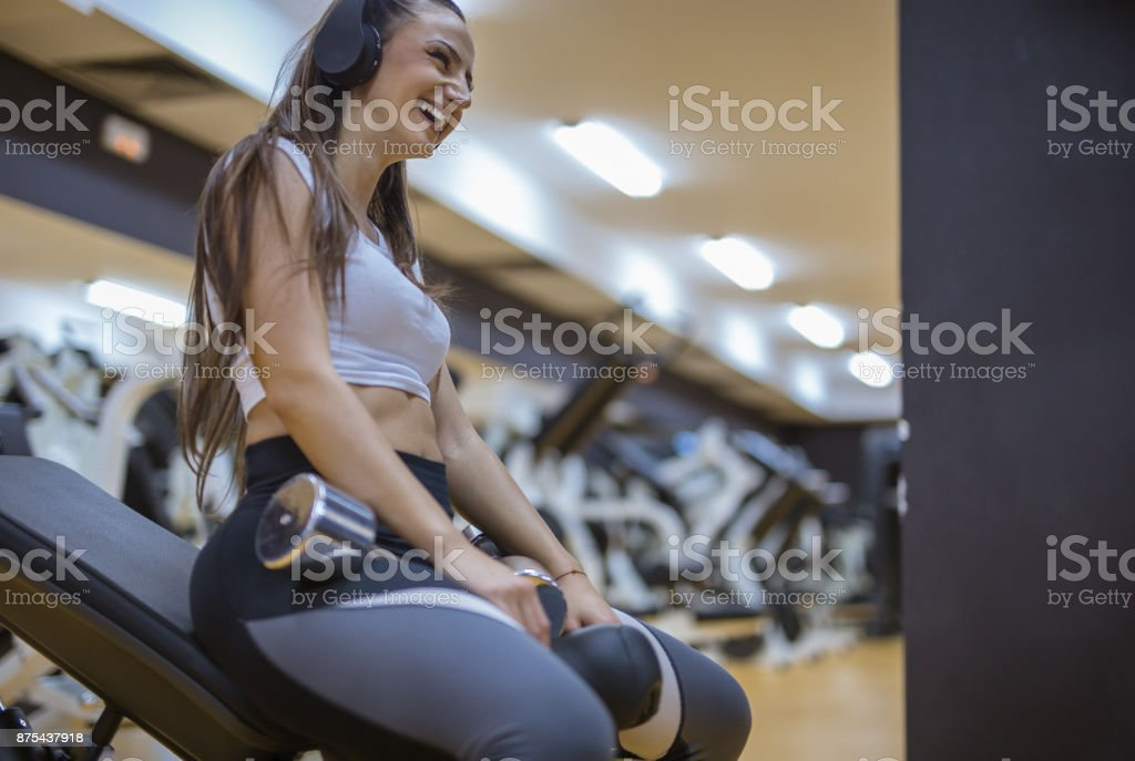 Candid emotion of female laughing at gym stock photo