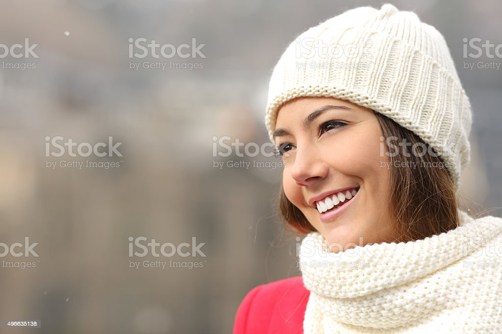 Candid girl with white teeth and smile in winter stock photo