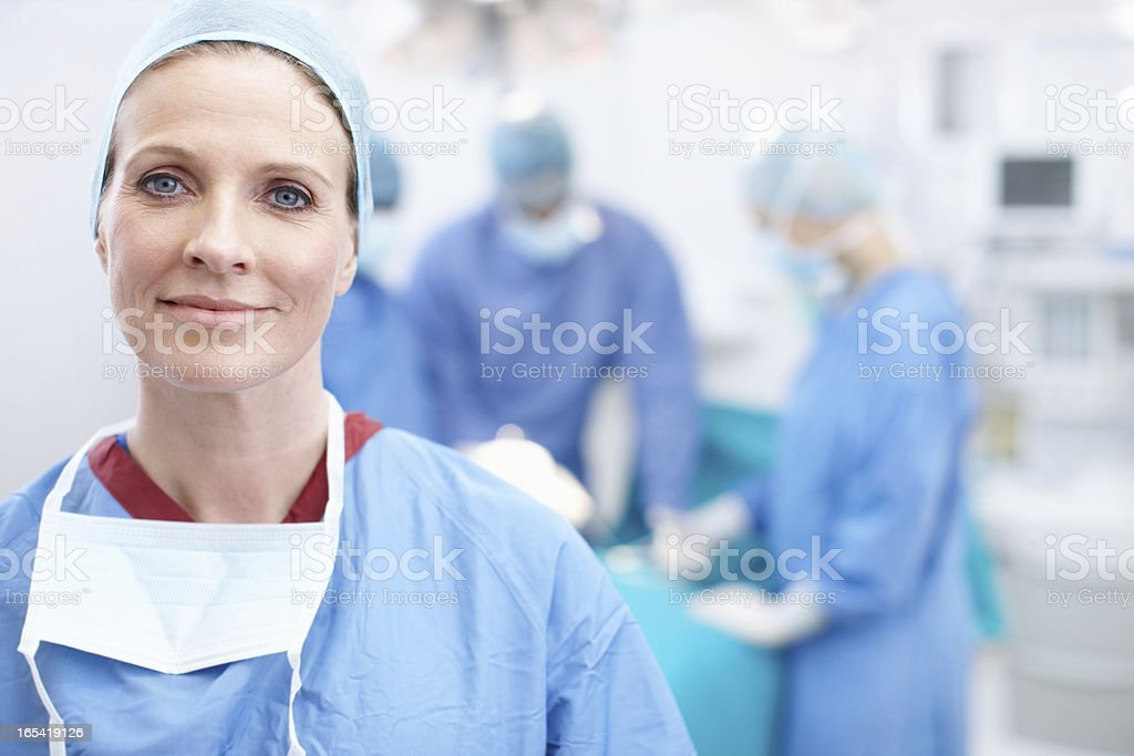 Candid image of an adult doctor in hospital scrubs stock photo