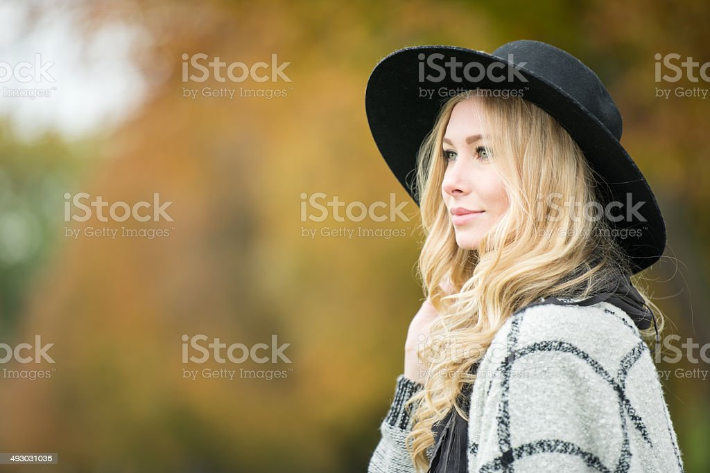 Candid Outdoor Portrait, Woman with Hat stock photo