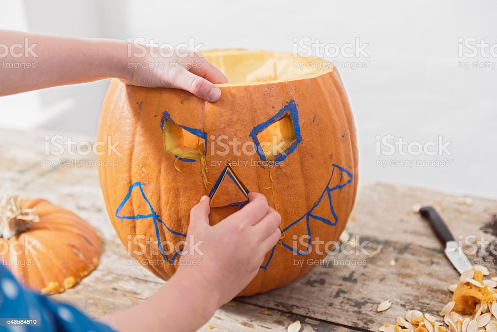 Candid Picture of  Young Girl Making Her Halloween Pumpkin stock photo