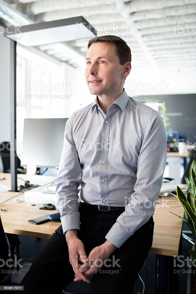 Candid portrait of a business man in an office stock photo