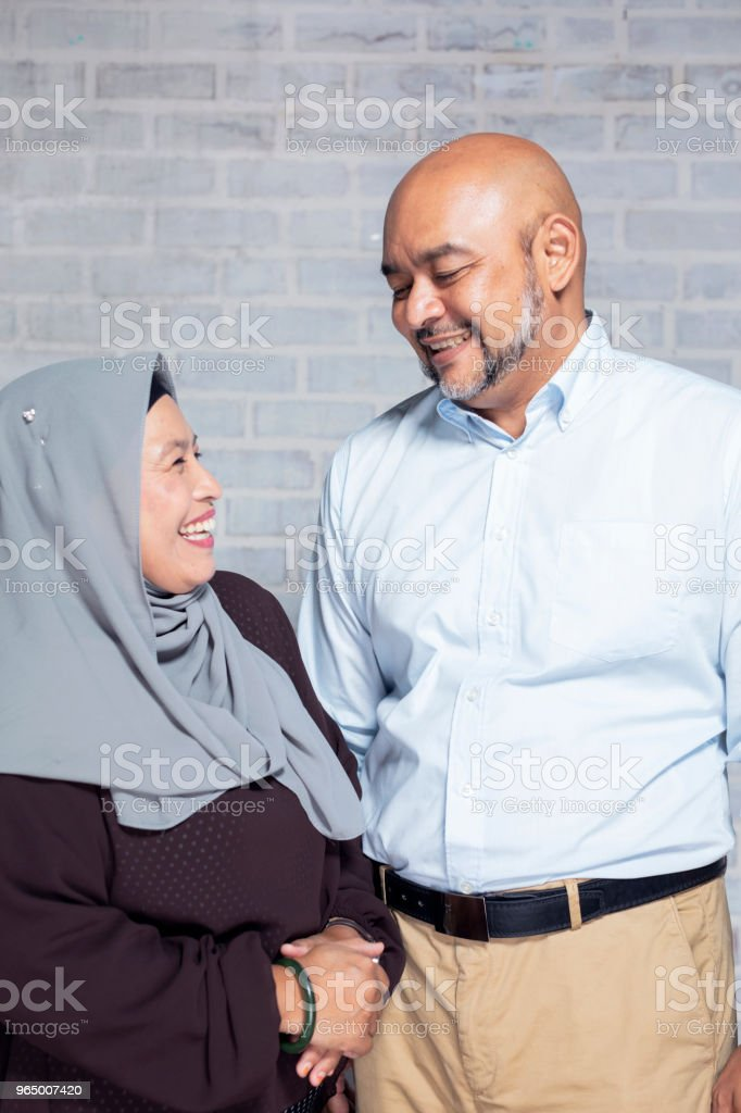 Candid portrait of a cheerful mature couple stock photo