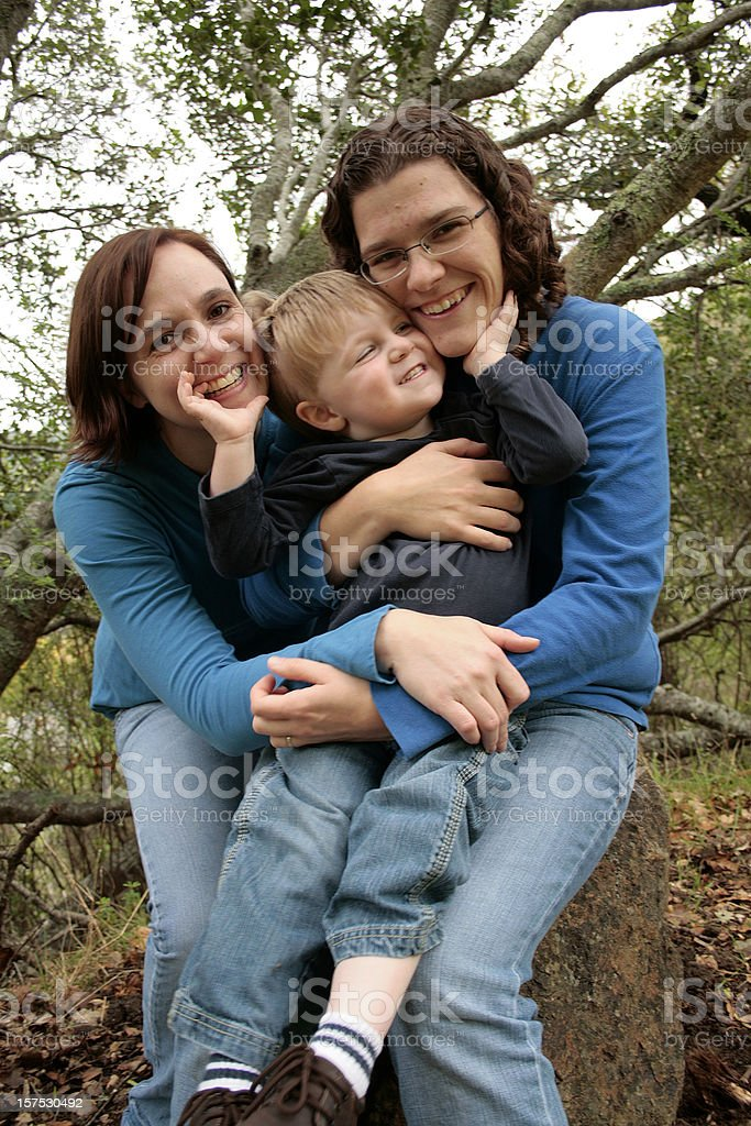 Candid Portrait of a Loving Three Person Family royalty-free stock photo