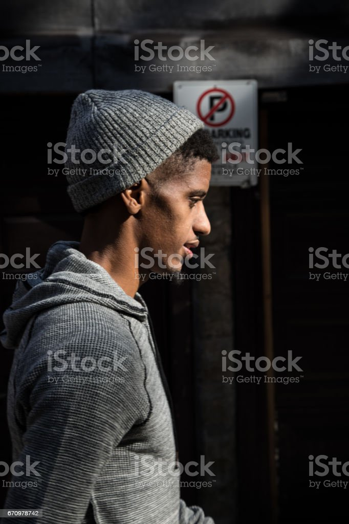 A candid portrait of a young, black man in Brooklyn, NYC stock photo