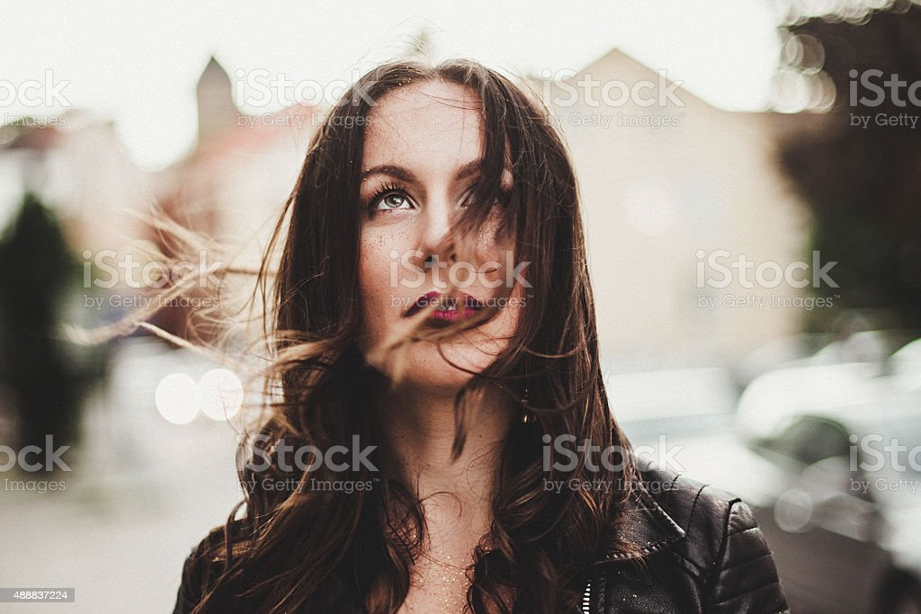 Candid portrait of beautiful woman in wind stock photo