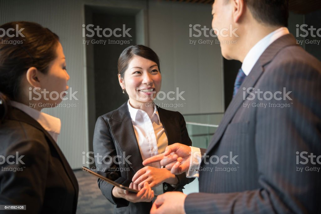 Candid portrait of three Japanese business colleagues stock photo