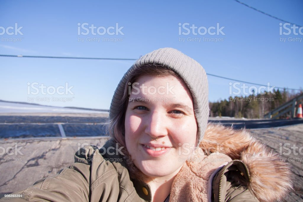 Candid Portrait of Young Smiling Body Positive Woman Outdoors stock photo