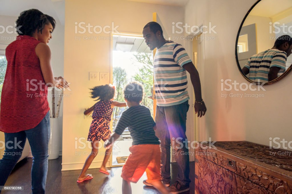 Candid shot of African American family in hallway stock photo