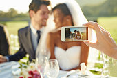 Shot of a wedding guest taking a photo of the bride and groom will a cellphonehttp://195.154.178.81/DATA/i_collage/pu/shoots/784347.jpg