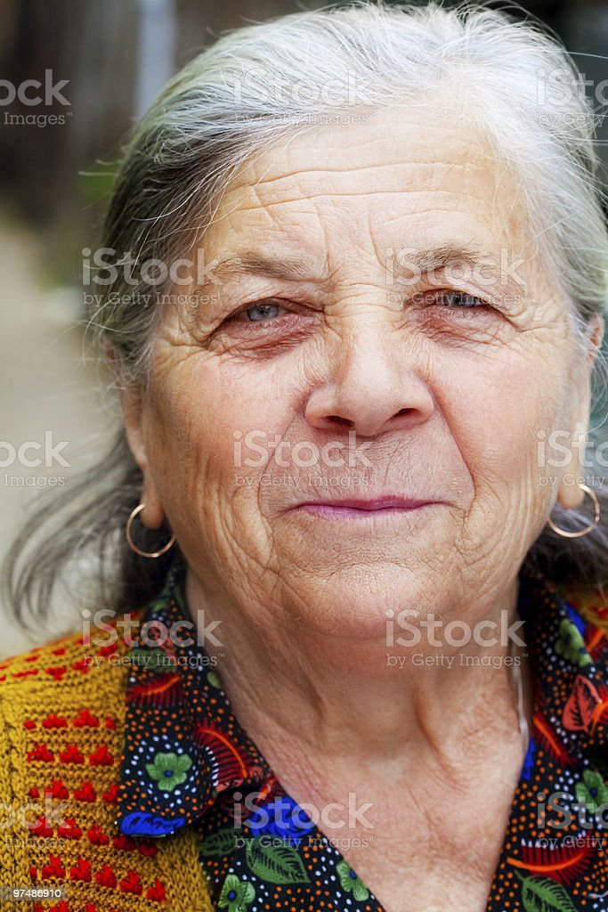 Candid smile of one happy senior woman royalty-free stock photo