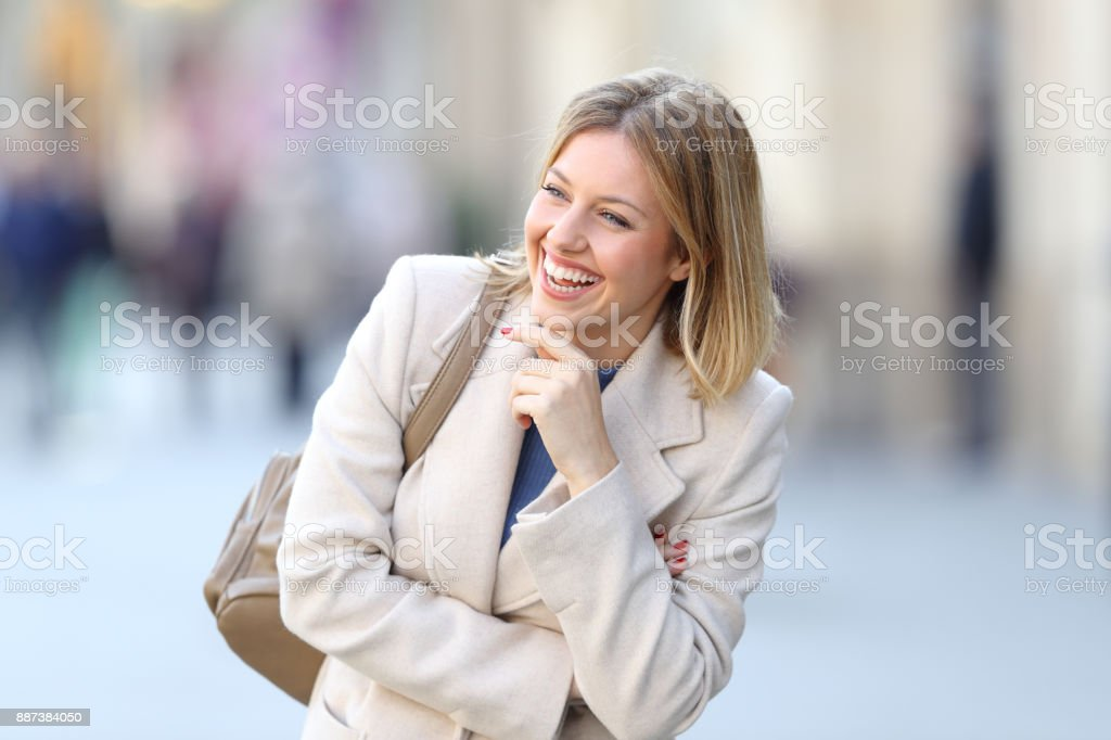 Candid woman laughing on the street stock photo