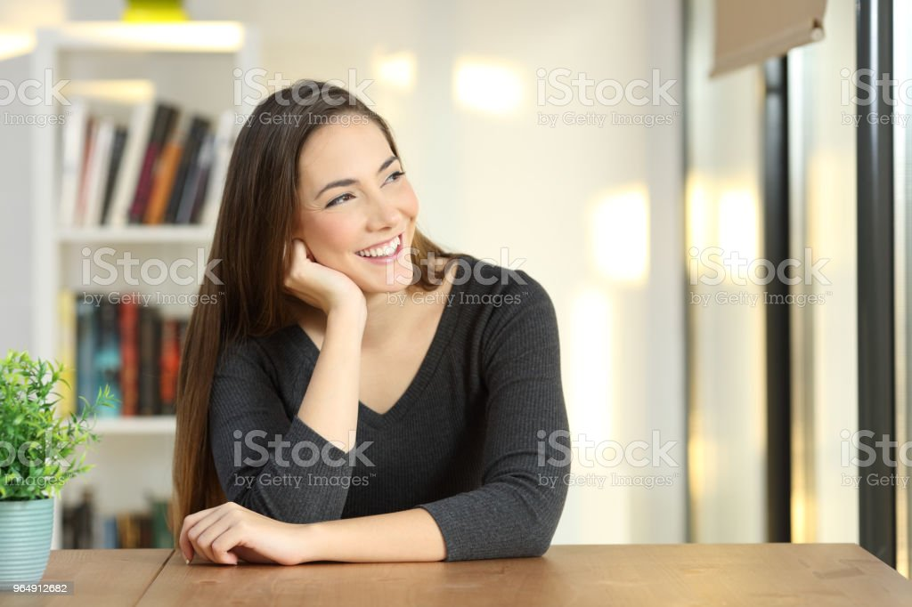 Candid woman thinking looking away at home royalty-free stock photo