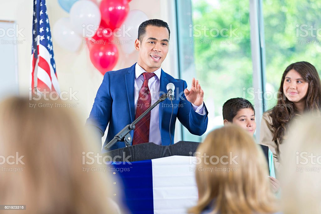 Candidate for city government answering questions during speech stock photo