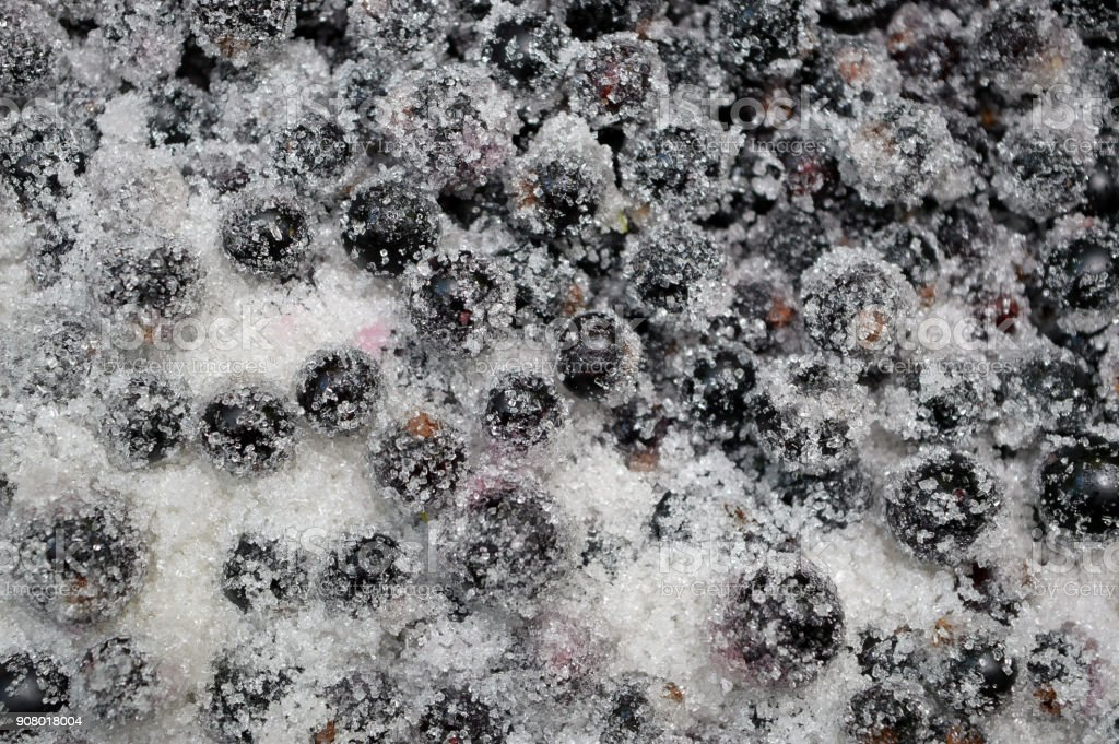 Candied berries of black currant. Close-up. Top view. Kitchen background. Preparation of berries for making jam. Traditional winter food. stock photo