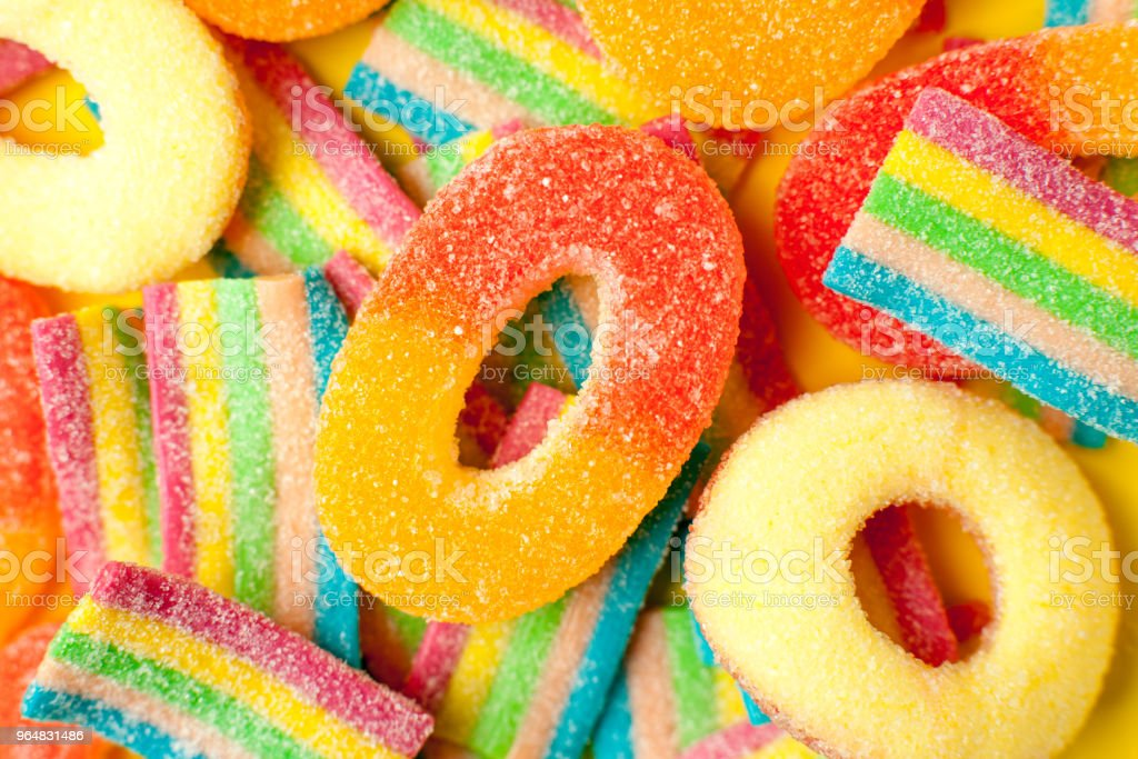 candies with jelly and sugar. colorful array of different childs sweets and treats. Bright party background royalty-free stock photo
