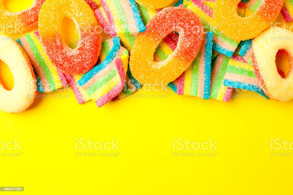 candies with jelly and sugar. colorful array of different childs sweets and treats. Bright party background zbiór zdjęć royalty-free