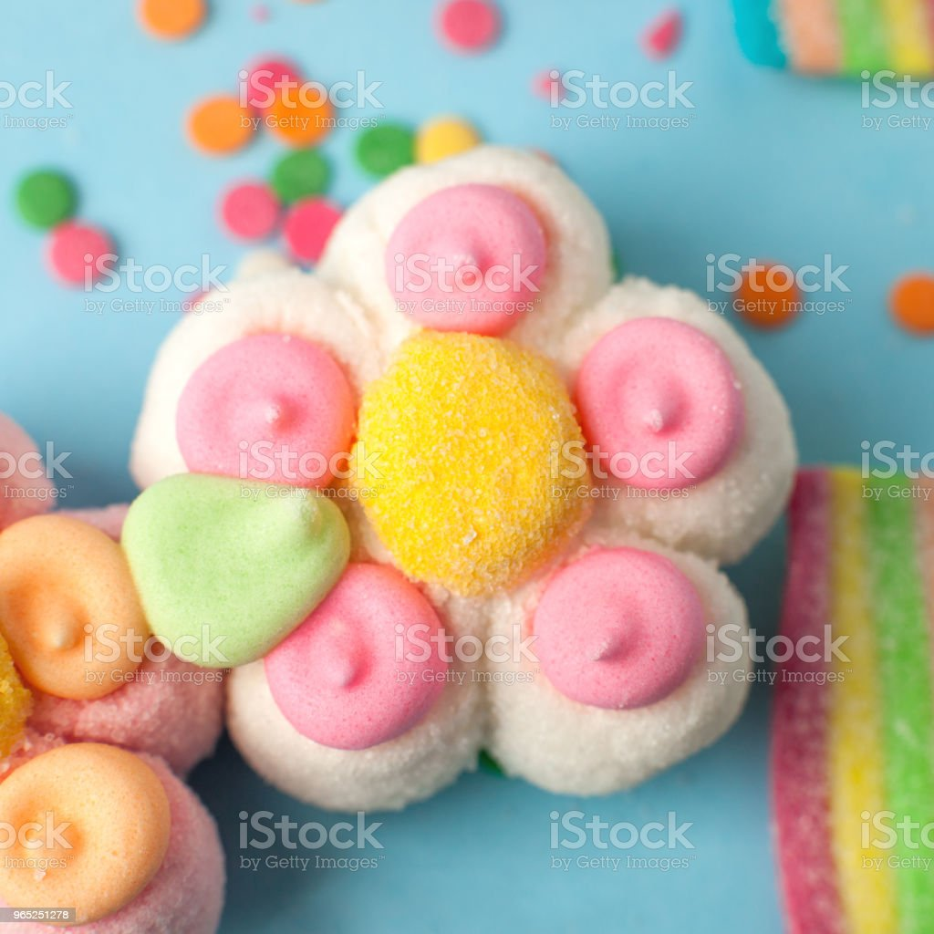 candies with jelly and sugar pattern. colorful array of different childs sweets and treats. Bright party background, kids sweetness flowers marmalade royalty-free stock photo
