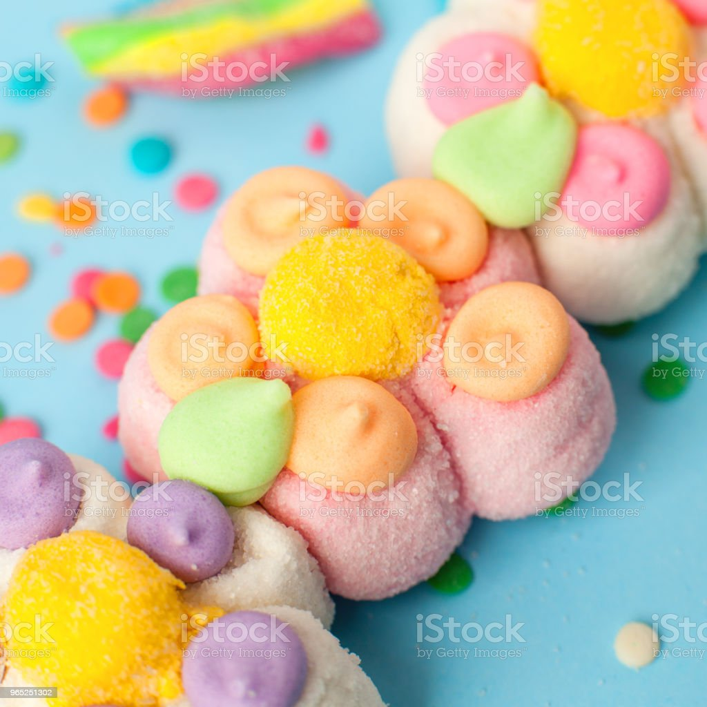 candies with jelly and sugar pattern. colorful array of different childs sweets and treats. Bright party background, kids sweetness flowers marmalade zbiór zdjęć royalty-free