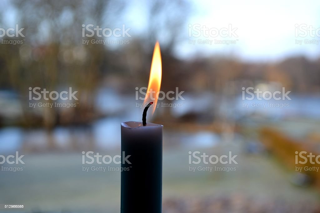 Candle against a stunning view stock photo