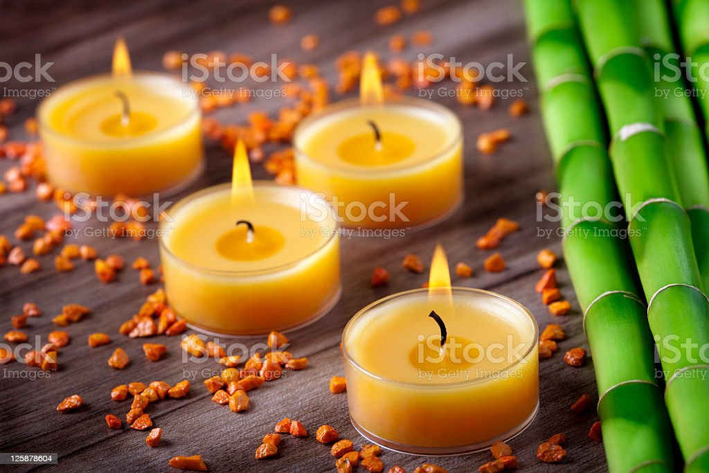 Candle and bamboo decoration stock photo