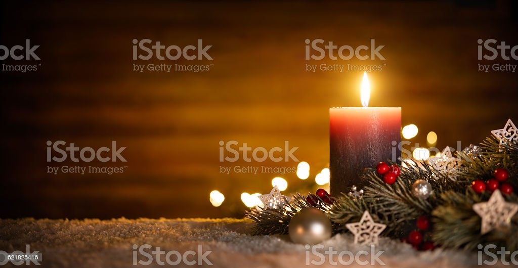 Candle and Christmas decoration with wooden background stock photo