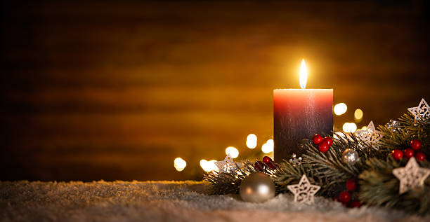 Candle and Christmas decoration with wooden background - Photo