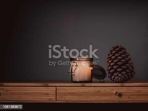 Candle and cone still life SImple photo with copy space