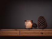 Candle and cone still life\nSImple photo with copy space