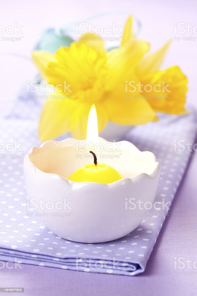 candle and daffodils royalty-free stock photo