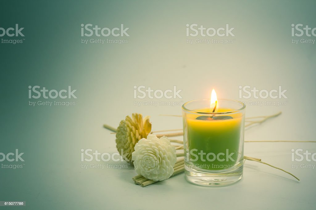 candle and flower in vintage tone stock photo